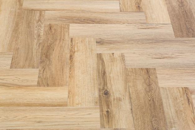 Laminaat en parket met visgraat houten vloer als achtergrond met een chevronpatroon