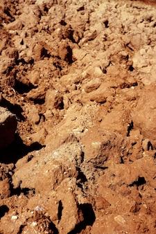 Landbouw gebied rode klei bodem textuur macro