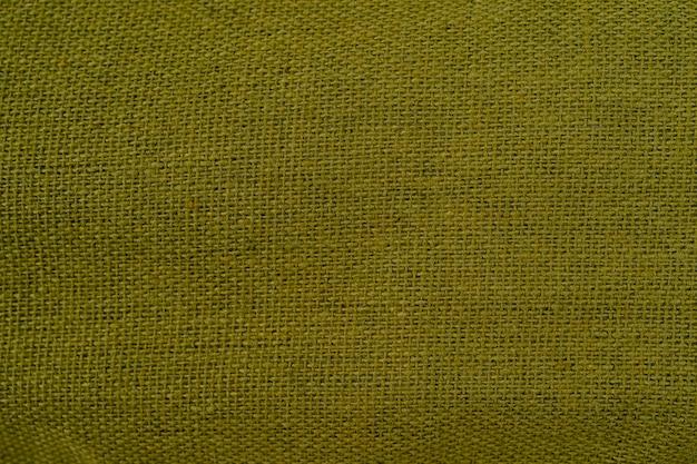 Landelijke textuur van jute achtergrond van zeer grove ruwe stof geweven gemaakt van vlasjute of hennep