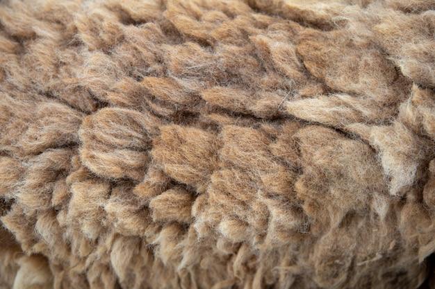 Lange schapenwoltextuur voor kledingtextiel