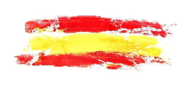 Lange vlag van spanje door penseelstreken geïsoleerd op de witte achtergrond