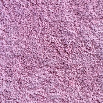 Langpolige tapijttextuur abstracte achtergrond van ruige roze vezels