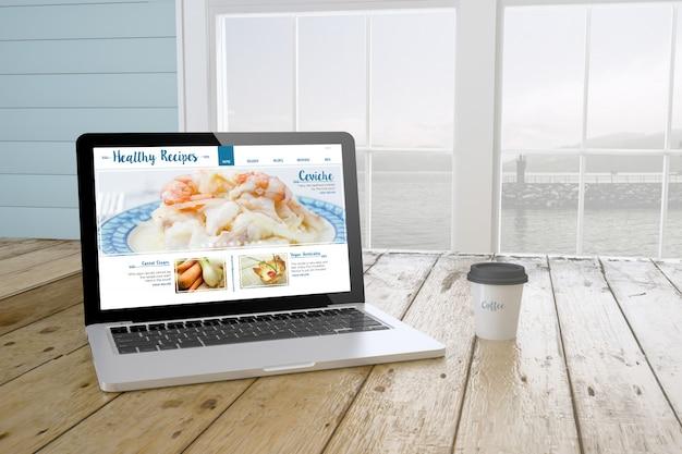 Laptop met gezonde recepten website op scherm met poort achtergrond en koffie