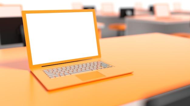 Laptop op tabel oranje kleur op werkplek selectieve aandacht.