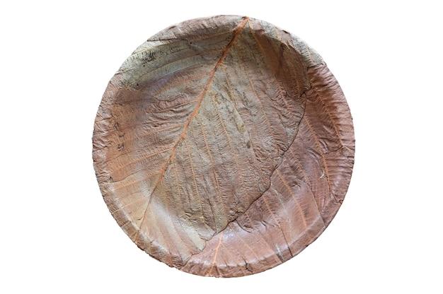 Leaf plate, milieuvriendelijk wegwerpbestek. bovenaanzicht op een witte achtergrond.