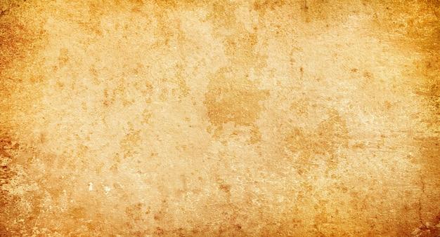 Leeftijd beige achtergrond, lege bruine grunge achtergrond, textuur van oud papier vlekken