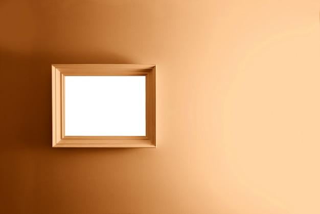 Leeg frame op de bronzen muur.