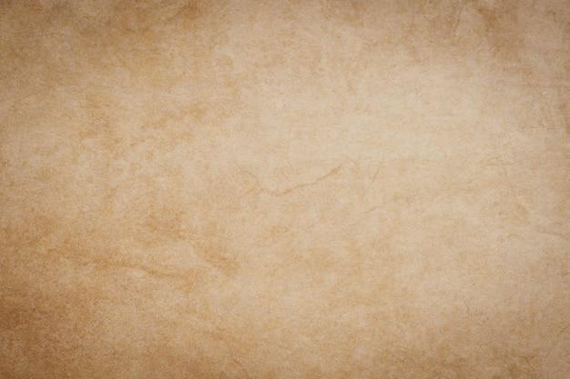 Leeg grunge bruin papier textuur en achtergrond met ruimte.