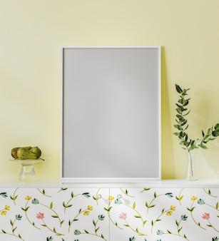 Leeg posterframe mock-up op het witte bureau met gele muur, helder interieur met bloemenprint, plant in vaas en fruit, 3d-rendering