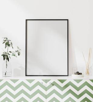 Leeg posterframe mockup in modern interieur met witte muur en groene commode met decoratie, scandinavische stijl, 3d-rendering