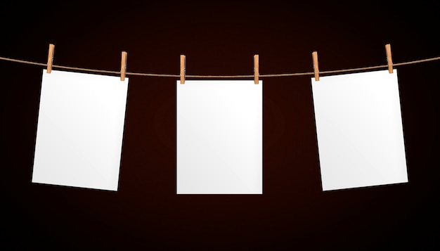 Leeg vel papier opknoping op touw