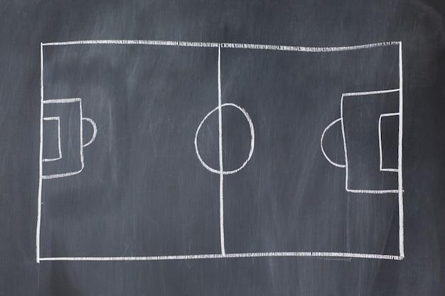 Leeg voetbalveld op een schoolbord