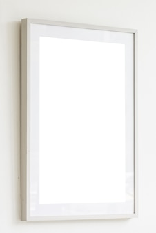 Leeg wit frame op witte muurachtergrond