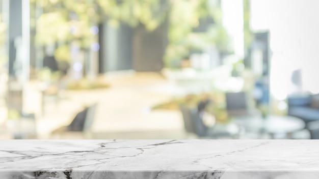 Leeg wit steen marmeren lijstbovenkant en vage abstracte achtergrond van winkelcomplexachtergrond