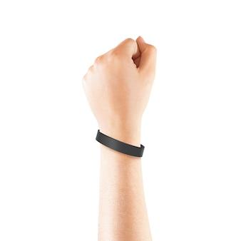 Leeg zwart rubberen polsbandje mockup bij de hand