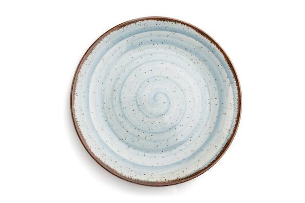 Lege blauwe keramische plaat geïsoleerd op wit