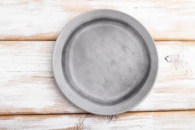 Lege grijze keramische plaat