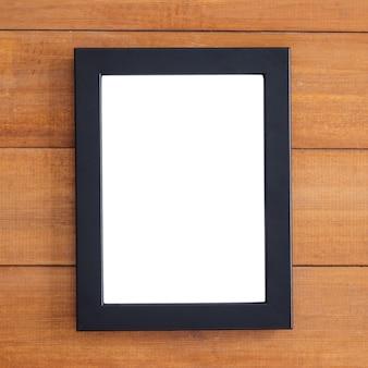Lege houten afbeeldingsframe op de tafel. kan worden gebruikt voor uw tekst of illustraties. bovenaanzicht