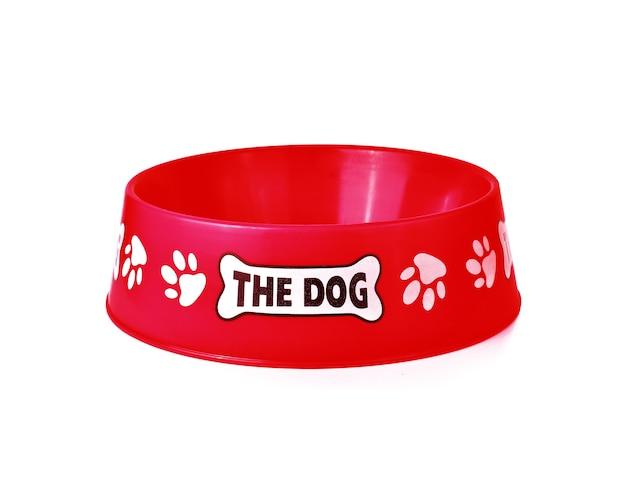 Lege huisdieren rode kom die op witte oppervlakte wordt geïsoleerd
