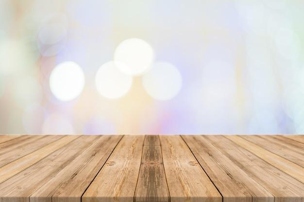 Lege perspectiefruimte met fonkelende bokehmuur en houten plankenvloer.