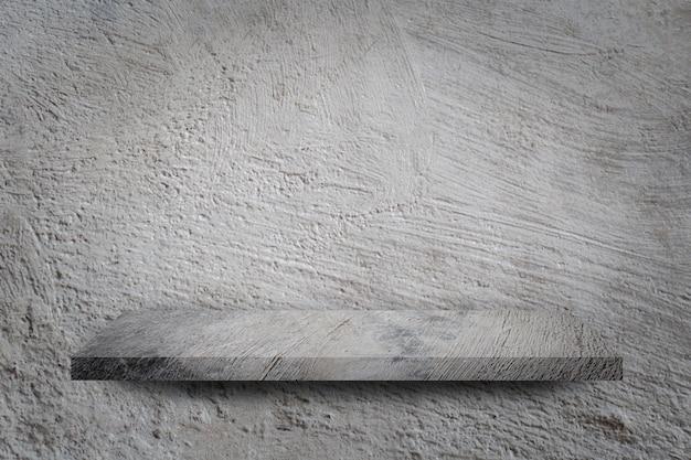 Lege plank over grijze betonnen muur achtergrond