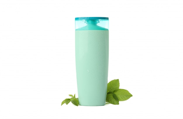 Lege plastic shampoo of lotionfles die op witte achtergrond wordt geïsoleerd