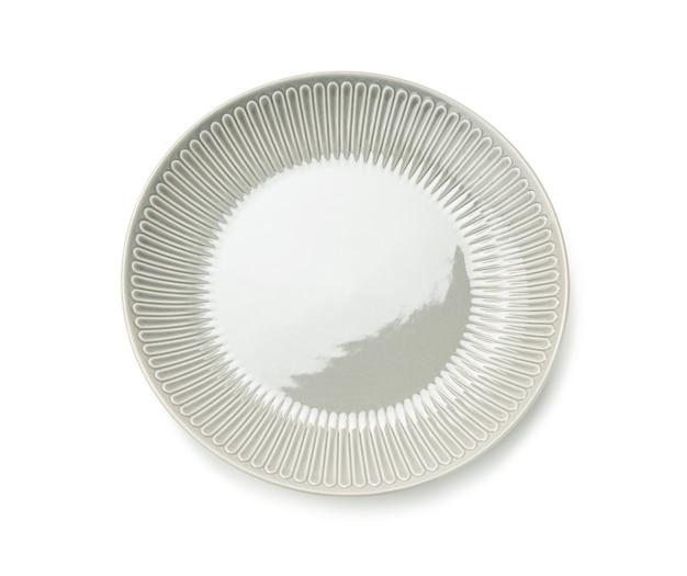 Lege ronde grijze plaat voor hoofdgerechten geïsoleerd op een witte achtergrond, bovenaanzicht