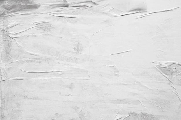 Lege witte verfrommeld en gevouwen papier poster textuur achtergrond