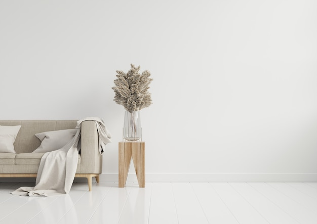 Lege woonkamer met bruine bank, decoratieve glazen pot en tafel op lege witte muur