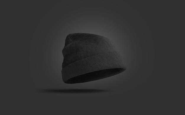 Lege zwarte gebreide muts op donkere ondergrond, 3d-rendering.
