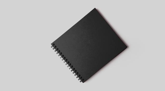 Lege zwarte notebook mockup met zachte schaduwen op neutrale grijze betonnen achtergrond.