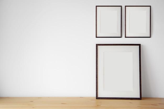 Lege zwarte omlijsting op de witte muur en de houten vloer.