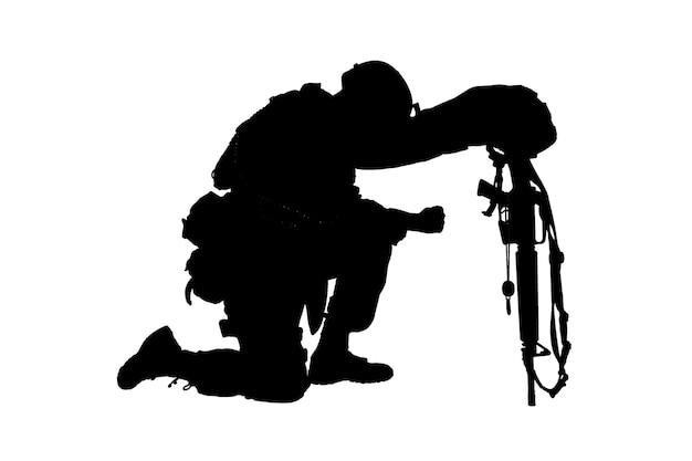Leger soldaat in verdriet voor gevallen kameraad staande op de knie dog tags op ketting studio shoot geïsoleerd op wit low key silhouet militaire begrafenis eert verdriet om gedood in actie