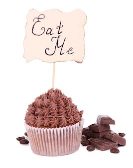 Lekkere cupcake met botercrème op wit wordt geïsoleerd