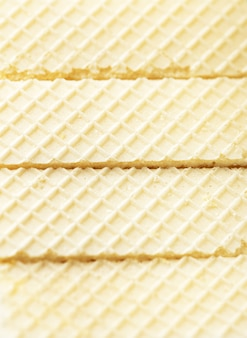 Lekkere en smakelijke koekjes met geruite print op het oppervlak. wafeltjes stijl naadloze patroon achtergrond. lekkere wafels of cracker. ruimte kopiëren. zoet dessertconcept.