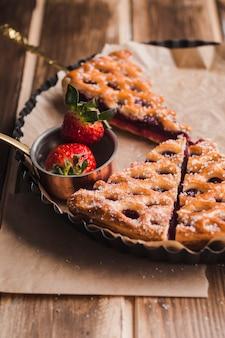 Lekkere taart besprenkeling met poedersuiker