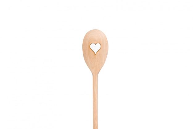 Lepel. houten lepels met hart motief op wit