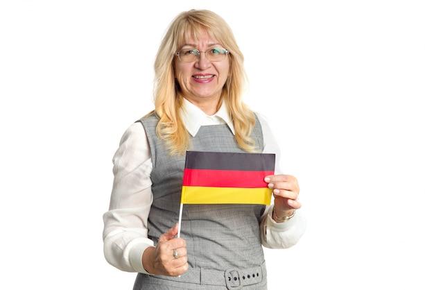Leraar. gelukkige rijpe vrouw met vlag van duitsland