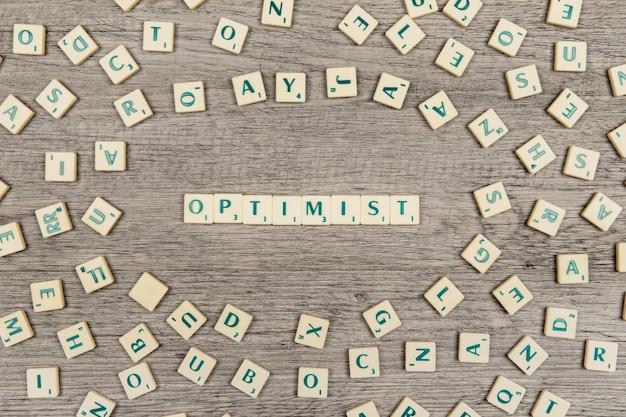 Letters die het woord optimist vormen