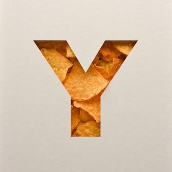 Lettertypeontwerp, abstract alfabet lettertype met driehoekige maïs chips, realistische bladeren typografie - y