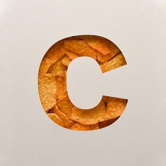 Lettertypeontwerp, abstract alfabetlettertype met driehoekige maïsspaanders, realistische blaadentypografie - c.