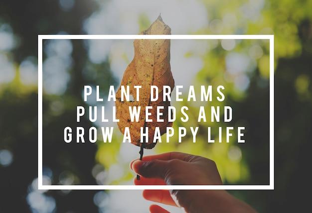 Levensmotivatie inspireert positieve vibes citaat op natuur blad achtergrond