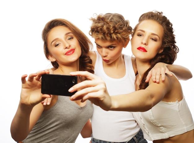 Levensstijl en mensenconcept: meisjes beste vrienden die selfie nemen