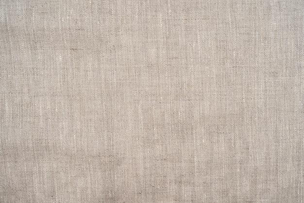 Licht beige katoenen stof textuur achtergrond naadloze patroon van natuurlijke textiel linnen background