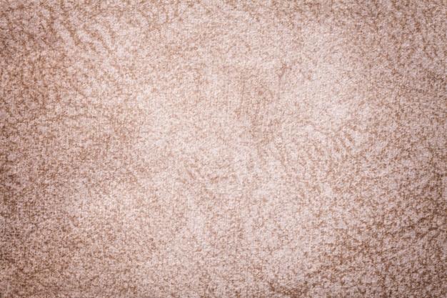 Licht beige pluizige achtergrond van zachte, wollige doek.