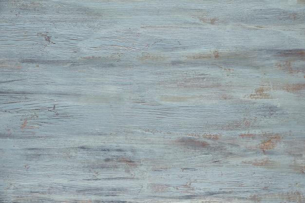 Licht grijsblauwe houten textuur met gecraqueleerde verf. oude grunge oppervlak, kopie-ruimte