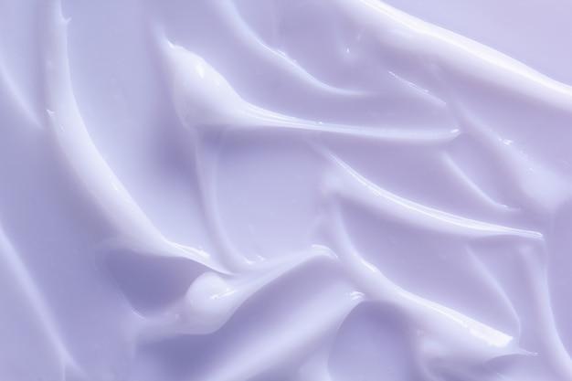 Licht paarse cosmetische lotion textuur