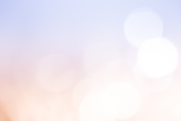 Licht perzikblauw bokehlicht. abstracte achtergrond.