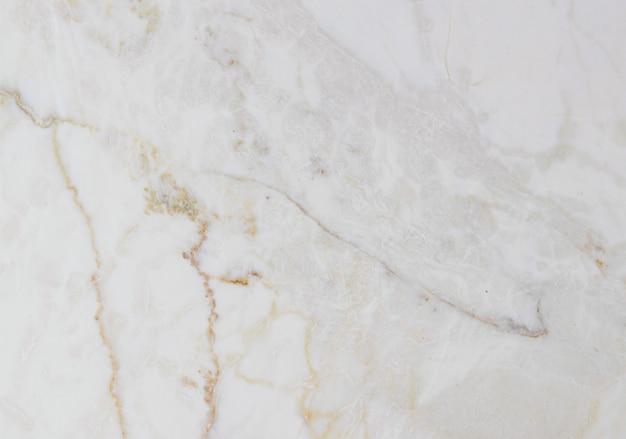Lichtbeige onyx marmeren natuursteen achtergrond, matte textuur