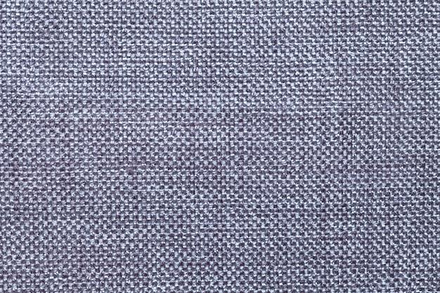 Lichtblauwe achtergrond met rieten patroon, textuurclose-up.
